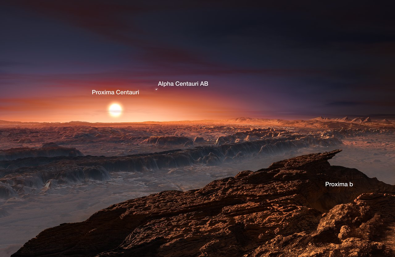 This artist's impression shows a view of the surface of the planet Proxima b orbiting the red dwarf star Proxima Centauri, the closest star to the Solar System. The double star Alpha Centauri AB also appears in the image. Proxima b is a little more massive than the Earth and orbits in the habitable zone around Proxima Centauri, where the temperature is suitable for liquid water to exist on its surface.